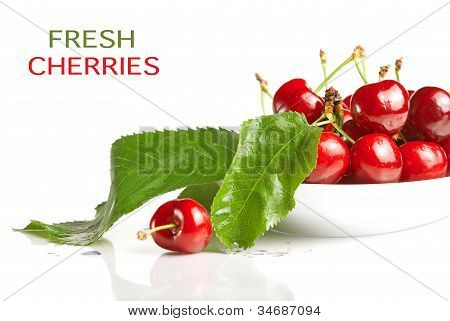 Fresh Cherry Berries With Green Leaves Isolated On White