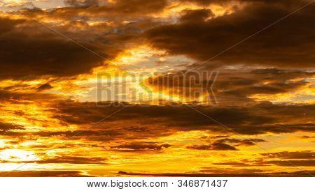 Beautiful Sunset Sky. Golden Sunset Sky With Beautiful Pattern Of Clouds. Orange, Yellow, And Dark C