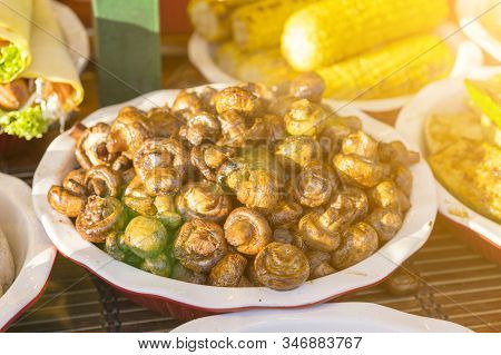 Fried Champignons. Fragrant Fried Champignons. Grilled Mushrooms In A Beautiful Plate. Street Food C