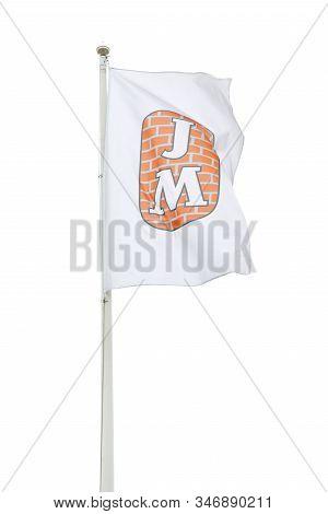 Sodertalje, Sweden - January 18, 2020: The Jm Company Flag Against A Bright Sky. Jm Is A Developer O