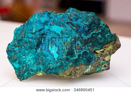Copper Ore From A Copper Mine In Chile, A Green Stone On A White Background.