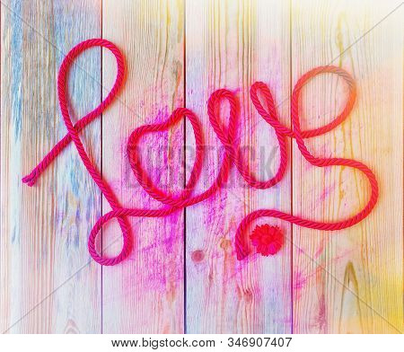 The Word Love Created From Red Rope, Toned. Love Concept. Valentine Day Background.