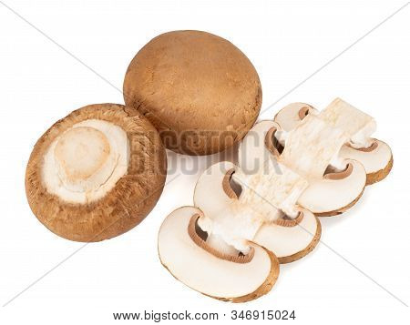 Champignons And Four Champignon Slices On A White Background