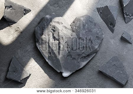 Heart Made Of Concrete Or Stone Near Stone Fragments. 3d Rendering.