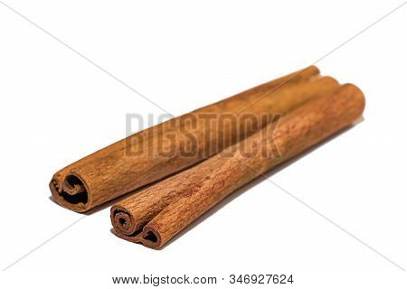 Flavored Cinnamon Sticks Isolated On A White Background. Two Sticks Of Dried Cinnamon Isolated On A