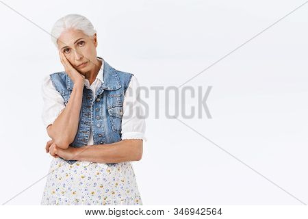 Tired, Fed Up Senior Woman With Combed Grey Hair, Lean On Palm, Look Camera Bothered With Slight Fat