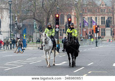 London, Uk - January 1, 2020: Mounted Horse Female Police Officer On The Street Near Westminster Abb