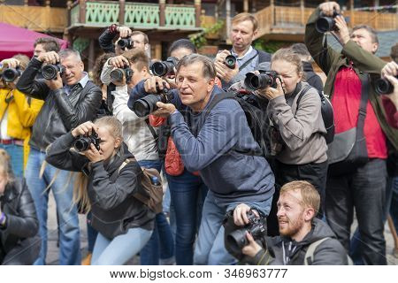 Moscow, Russia, August 16, 2019. Moscowphotovideofest. Group Of Photographers With Cameras At Photo