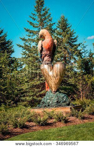 Frederik Meijer Gardens- Grand Rapids, Mi /usa - September 4th 2016: Parrot And A Golden Heart Statu