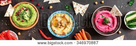 Colorful Hummus Bowls, Healthy Vegan Dips. Traditional Middle Eastern Hummus, Green Hummus, Beetroot