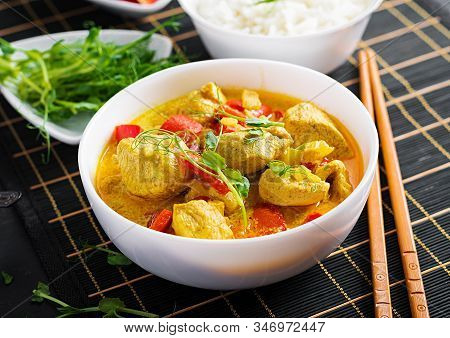 Indian Chicken Curry With Basmati Rice In Bowl.  Traditional Indian Dish. Chicken Tikka Masala. Indi
