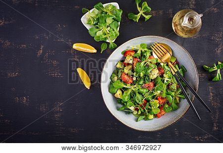 Fresh Salad Tomato, Avocado, Corn Salad And Chia Seed. Healthy Food Concept. Vegetarian / Vegan Cuis