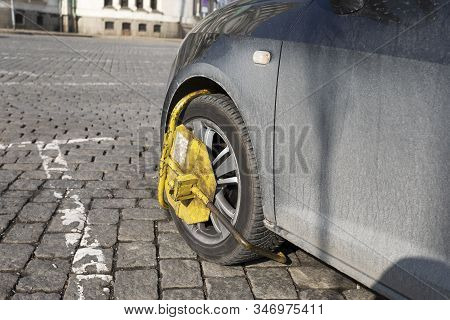 Wheel Clamp-on An Illegally Parked Vehicle, Wheel Clamp Close.