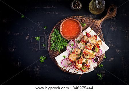 Grilled Chicken Kebab With Paprika On A Wooden Board.  Grilled Meat Skewers, Shish Kebab On Dark Bac