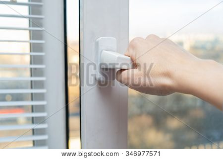 Hand Opening A Plastic Window To Air The Room For Fresh Air In Spring And Summer, Sunny Day