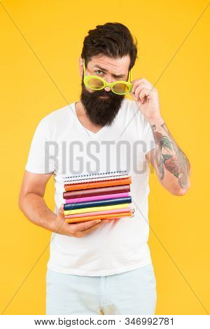 Supplies For Arts And Drawing. Notepad Notebook. Hipster Eccentric Guy Hold Pile Notepads. Stationer