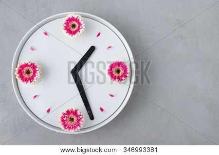 Flower Clock Flat Lay. Spring Time Background. Creative Arrangement Of White Clock Created From Fres