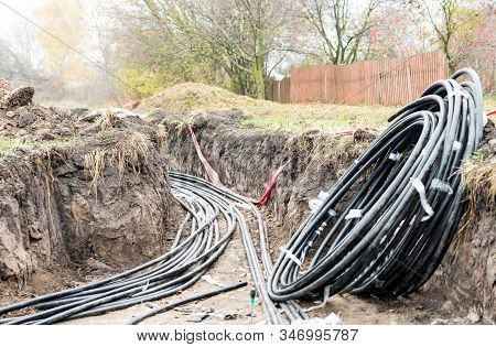 Laying Of High-voltage Cable Lines In The Earth Trench