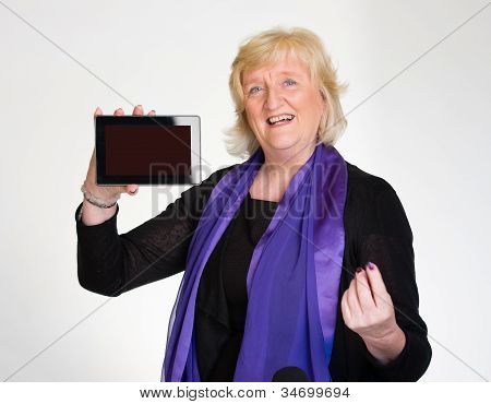 Senior Woman Displays Tablet Computer