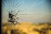 Broken window cracked glass on urbanic background poster