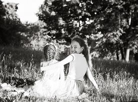 Two Happy Cute Little Girls Laughing And Hugging At The Summer Park. Happy Chidhood Concept. Black A