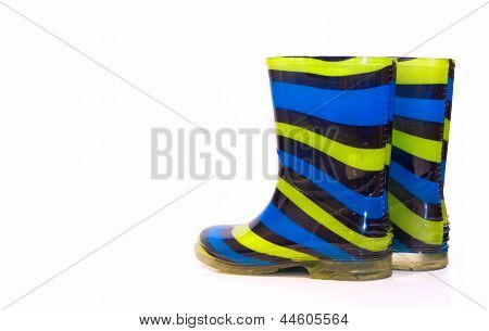 Multi Coloured Wellington Boots On White With Copy Space