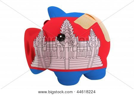 Closed Piggy Rich Bank With Bandage In Colors National Flag Of Cambodia
