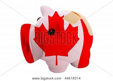 Closed Piggy Rich Bank With Bandage In Colors National Flag Of Canada