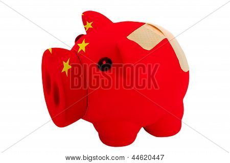 Closed Piggy Rich Bank With Bandage In Colors National Flag Of China