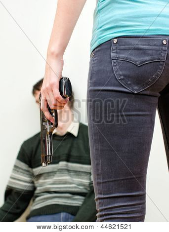 Woman killing man with a gun. Home violence concept poster