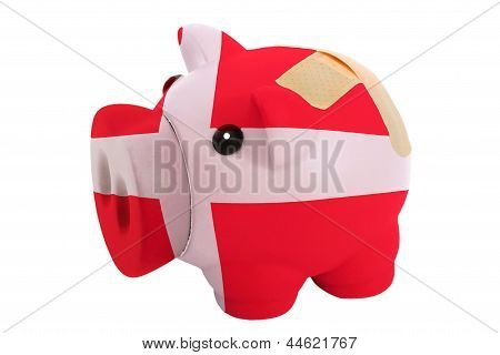 Closed Piggy Rich Bank With Bandage In Colors National Flag Of Denmark