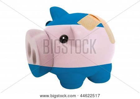 Closed Piggy Rich Bank With Bandage In Colors National Flag Of El Salvador