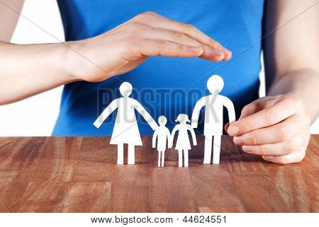 Hand Protecting A Family