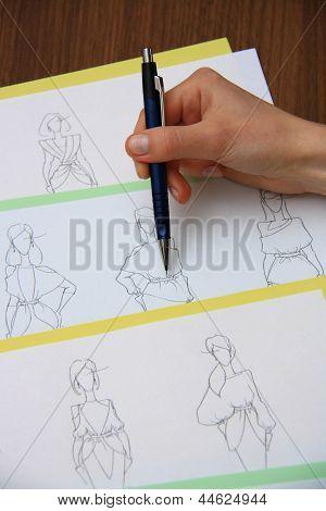Designer Assessing Fashion Drawings