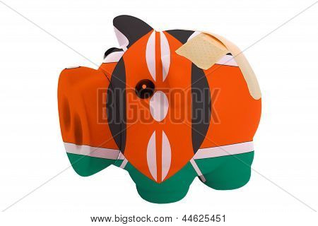 Closed Piggy Rich Bank With Bandage In Colors National Flag Of Kenya