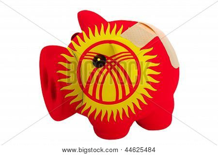 Closed Piggy Rich Bank With Bandage In Colors National Flag Of Kirghizstan