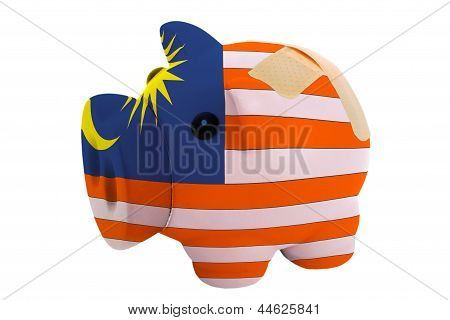 Closed Piggy Rich Bank With Bandage In Colors National Flag Of Malaysia