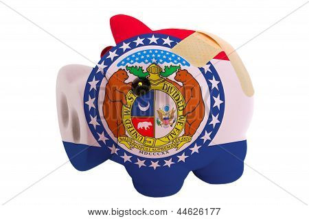 Closed Piggy Rich Bank With Bandage In Colors Flag Of American State Of Missouri