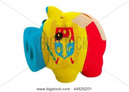 Closed Piggy Rich Bank With Bandage In Colors National Flag Of Moldova
