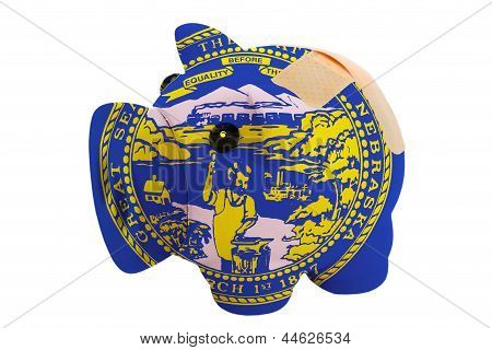 Closed Piggy Rich Bank With Bandage In Colors Flag Of American State Of Nebraska