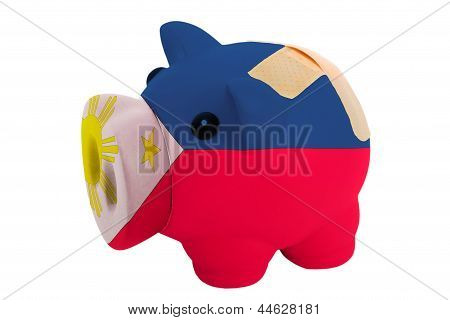 Closed Piggy Rich Bank With Bandage In Colors National Flag Of Philippines