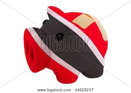 Closed Piggy Rich Bank With Bandage In Colors National Flag Of Trinidad Tobago
