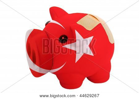 Closed Piggy Rich Bank With Bandage In Colors National Flag Of Turkey