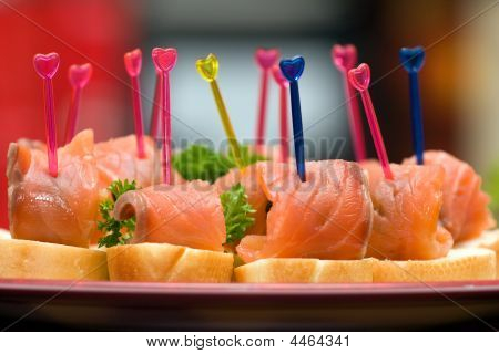 Catering - salmon with olive canape appetizer poster