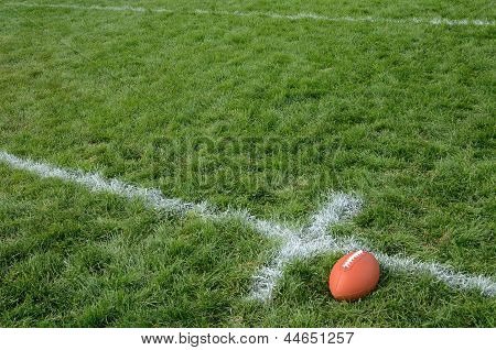 American Football On Natural Grass Turf