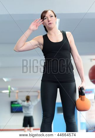 Young Woman Exercising With Kettle Bell Weight