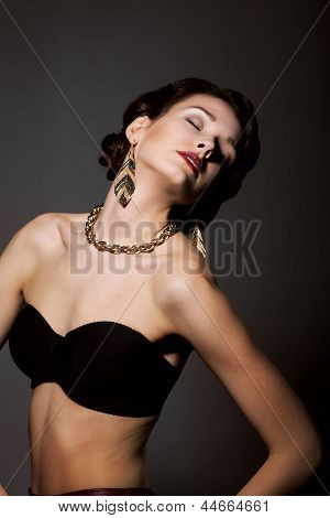 Bliss. Sultry Graceful Beauty In Black Bra With Golden Jewelery - Necklace And Earrings