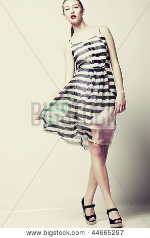 Selfhood. Funky Woman Wearing Stylish Light Fluttering Dress