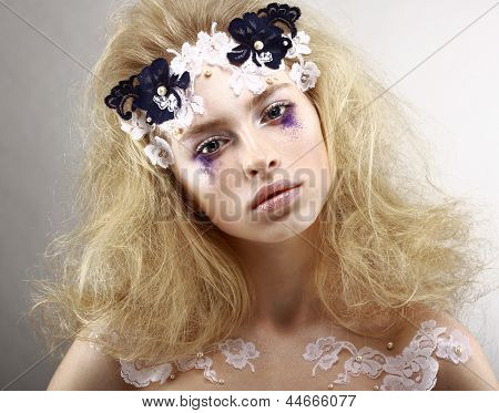 Young Styled Blonde With Colorful Makeup - Blue Eye Shadows. Arts