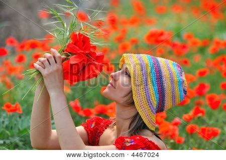 Young Woman Between Poppies